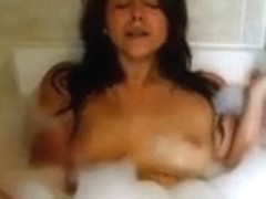 Amateur college girl fingers herself in the bathtub
