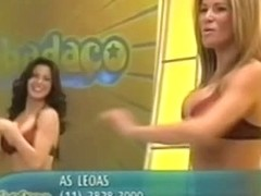 Scantly dressed dancer girls tease the audience with their tits and asses
