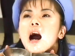 Beautiful Japanese girl in a blue outfit gets hot cum all over her face