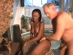 A curvy black babe enjoys some soapy interracial fun in a hot tub