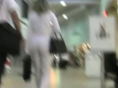 Remarkable street candid of a pretty woman in white suit