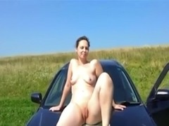 Lascivious wife posing on car