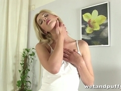 Blonde girl fucks her pussy with a bannana