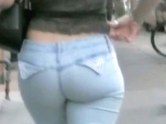 Fit blonde walking down the street candid with a superb body