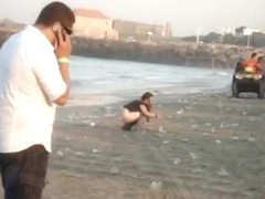 A fresh boozed girl pissing in public on the beach