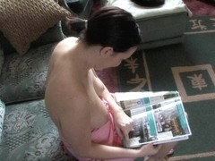 Lovely brunette reads and shows tits in down blouse style