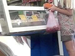 Public upskirt with hot blonde filmed in the market