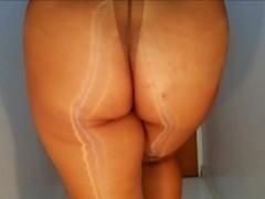 Shiny pantyhose on corridor