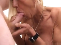 Naughty blonde granny in stockings has her doctor satisfying her needs
