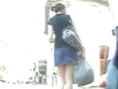 This madame in blue skirt is walking like a sexy model