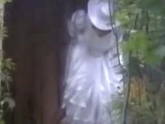 Hidden piss cam brunette woman in a long dress