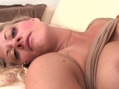 Busty blonde Holly Heart was lying on the couch and masturbating her twat and her boyfriend was spying her.