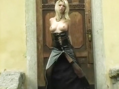 Sexy blonde in all leather whips dem boobies out!
