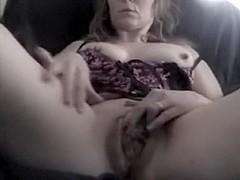 Aged wife fingers her wet crack close Up