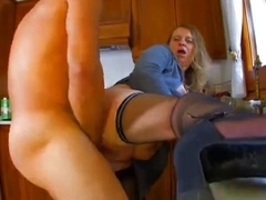 Milf is fucked in doggy style on the counter kitchen