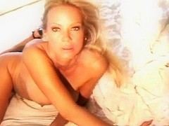 Beautiful blonde MILF naked on a bed