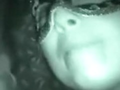 Masked babe sucks cock in a glory hole.