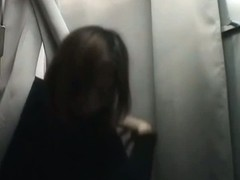 Hidden camera in changing room gets Asian babe's boobs