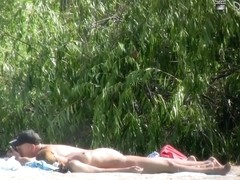 Beach nudist hunter voyeuring nude bodies from behind bushes