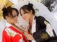Two hot girls suck a big black dick