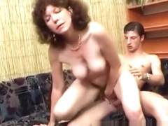Luscious mature lady has a young stud deeply pounding her hairy snatch