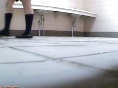 Frisky schoolgirl sits on hunkers and masturbates up skirt