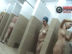 Hot granny and a teen in the shower caught on a spy xxx cam