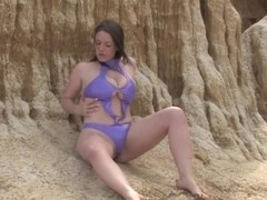 Girls Out West - Busty babe fucks a dildo by the sea