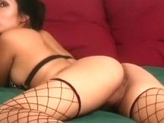 Leilene wears her fishnet stockings while posing and showing her hot ass