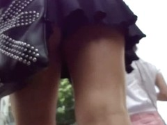 Spy cam sequence of two slim teens shot up skirts