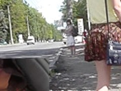 Upskirting young girlfriend that is waiting for a bus
