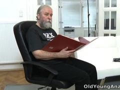 Ulia leans back on the white sofa and gets her pussy eaten out by her older man.