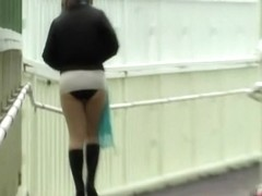 Asian beauty gets a skirt sharking on a cold, gloomy day.