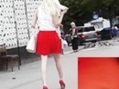 Blond in red gripping with sexy upskirt