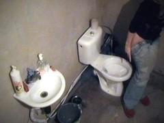 Toilet voyeur pissing