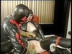 Tied slut in latex gets fingered and sucks a dong