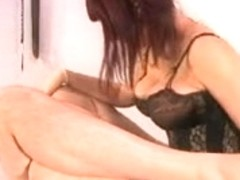 Busty hottie fucks a guy with a strapon shaft