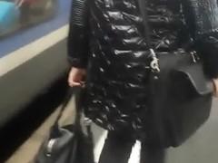 Black down jacket in street