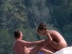 Married couple are teasing each other on the beach video