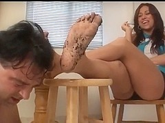 She laughs hysterically while he licks her dirty feet