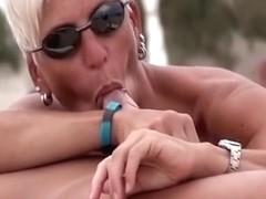Nudist female sucking dick on beach voyeur camera