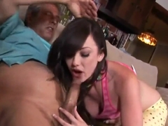 Black haired Jennifer White takes her lover's dick in her warm and gentle mouth