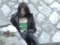 Gorgeous Asian babe texting on some stairs boob sharked.