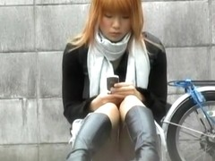 Stunning colorful admirable chick messing with her phone during sharking scene