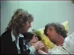 Busty nurse fucks in a classic porn movie