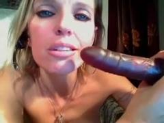 Busty blonde toys her twat on webcam