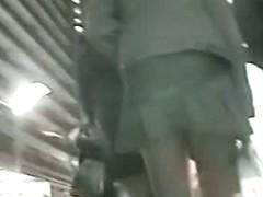 Hot chick's ass caught up skirt wearing white panties