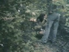 A couple hiding in vain in the woods to take a piss voyeur video