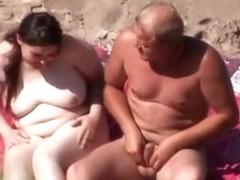Banging on the beach rocks