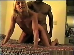 Cuckold tapes a black bull fucking his wife with condom and she swallows